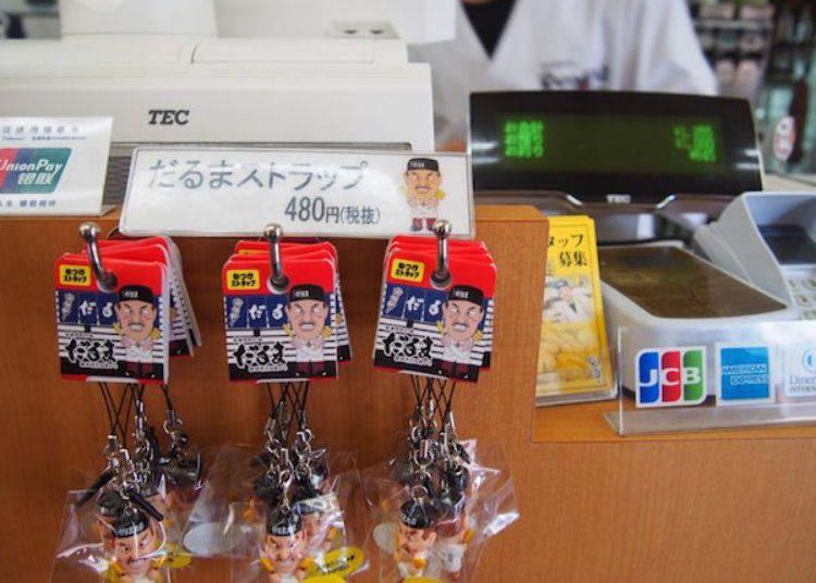▲The familiar Daruma Chairman character. They sell Daruma Chairman straps and other souvenirs.