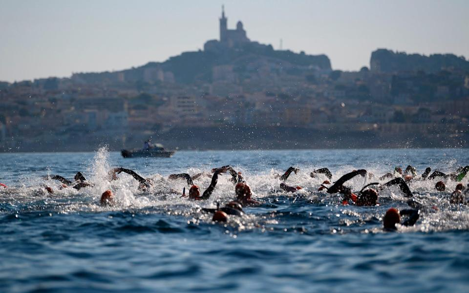 "swimmers during the 22nd edition of the ""Le Defi Monte-Cristo""  - Getty"