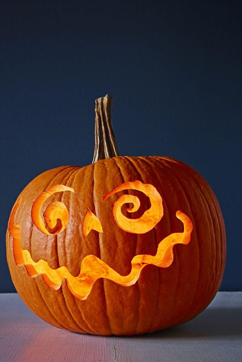"""<p>We love how these ghoulish features deviate from the classic jack-o'-lantern. Here's the trick to doing it yourself: Tape transfer paper to a pumpkin and draw on your design. Then remove the paper and follow the outline.</p><p><a class=""""link rapid-noclick-resp"""" href=""""https://www.amazon.com/Transfer-Stencil-Paper-15-Sheets/dp/B0036WEBLI/?tag=syn-yahoo-20&ascsubtag=%5Bartid%7C10055.g.23570028%5Bsrc%7Cyahoo-us"""" rel=""""nofollow noopener"""" target=""""_blank"""" data-ylk=""""slk:SHOP TRANSFER PAPER"""">SHOP TRANSFER PAPER</a></p>"""