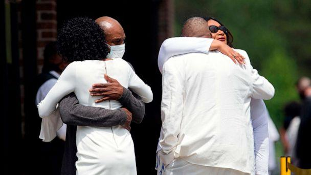PHOTO: Zsa-Zsa, left, and LaTonya Floyd, sisters of George Floyd, are embraced by family at the private viewing and memorial service outside the Cape Fear Conference B Church in Raeford, N.C., June 6, 2020, during a memorial for George Floyd. (Ryan M. Kelly/AFP via Getty Images)