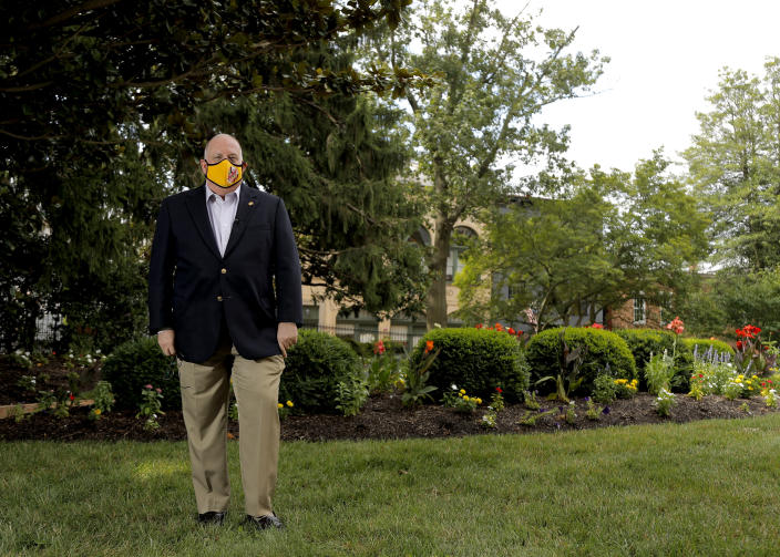 Maryland Gov. Larry Hogan poses for a photograph during an interview with The Associated Press to talk about his response to the coronavirus outbreak as chairman of the National Governors Association, Thursday, July 23, 2020, in Annapolis, Md. Hogan also discussed his book which is expected to be released next week. (AP Photo/Julio Cortez)