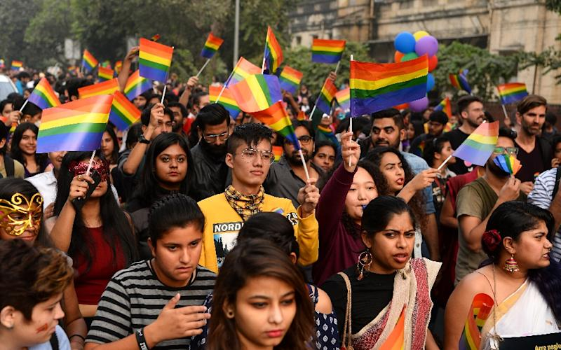 Members and supporters of the lesbian, gay, bisexual, transgender (LGBT) community take part in a parade in New Delhi last November