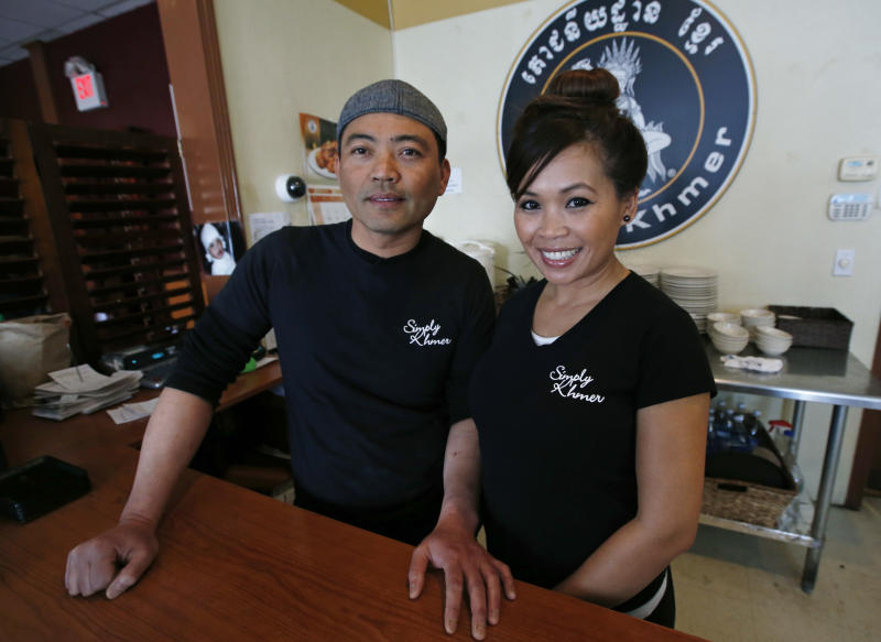 This March 14, 2014 photo shows Sambath Neang, left, and Denise Phon Ban, owners of Simply Khmer, at their Cambodian restaurant in Lowell, Mass. Simply Khmer is considered by some to offer the best _ and most authentic _ Cambodian food in the city. (AP Photo/Elise Amendola)