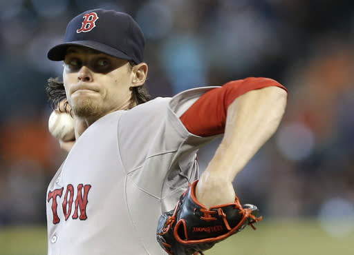 Boston Red Sox's Clay Buchholz delivers a pitch against the Houston Astros in the first inning of a baseball game Sunday, July 13, 2014, in Houston. (AP Photo/Pat Sullivan)