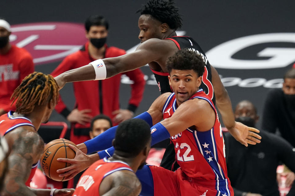 Philadelphia 76ers guard Matisse Thybulle (22) grabs a rebound away from Toronto Raptors forward OG Anunoby (3) during the first half of an NBA basketball game Tuesday, Feb. 23, 2021, in Tampa, Fla. (AP Photo/Chris O'Meara)