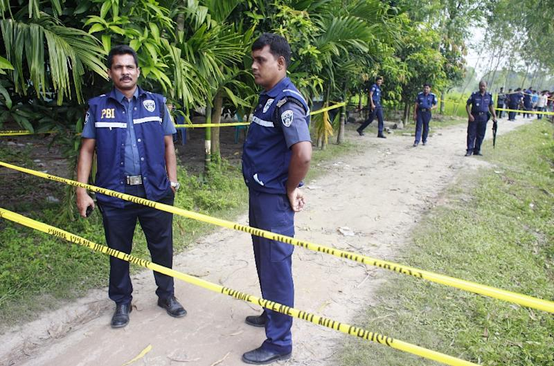 Bangladeshi police stand guard in Rangpur in October 2015 at the site where Japanese farmer Hoshi Kunio was shot to death