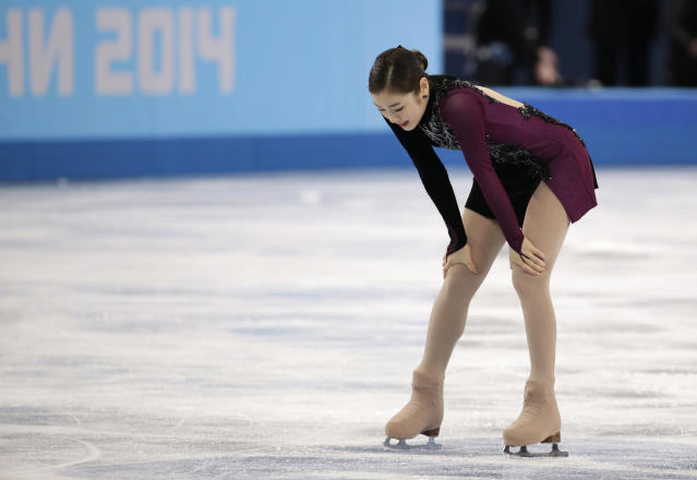 Yuna Kim of South Korea reacts after competing in the women's free skate figure skating finals at the Iceberg Skating Palace during the 2014 Winter Olympics, Thursday, Feb. 20, 2014, in Sochi, Russia. (AP Photo/Bernat Armangue)