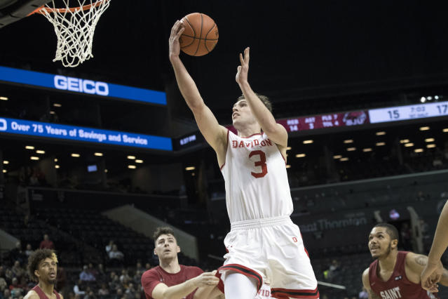 FILE - In this March 15, 2019, file photo, Davidson guard Jon Axel Gudmundsson (3), of Iceland, goes to the basket during the first half of an NCAA college basketball game against Saint Joseph's during the Atlantic 10 Conference tournament in New York. Gudmundsson was the Atlantic 10 player of the year last season and has filled up box scores in his career like few players in college basketball history. (AP Photo/Mary Altaffer, File)