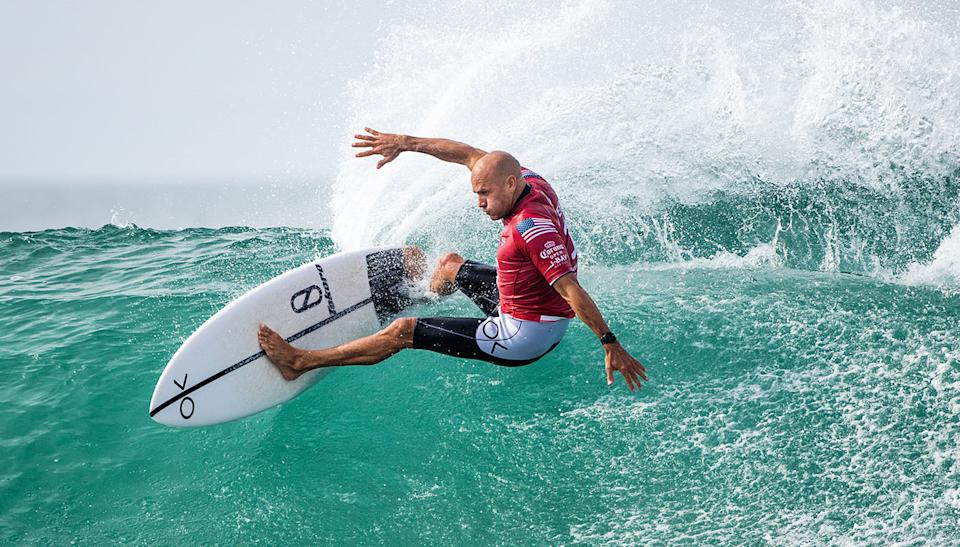 Champion Kelly Slater, with a traditionally-female first name, surfs at Jeffreys Bay, South Africa.