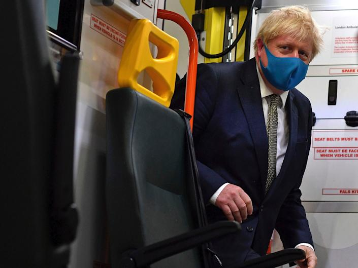 Britain's Prime Minister Boris Johnson boards an ambulance during a visit to the headquarters of the London Ambulance Service NHS Trust in London, on Monday July 13, 2020.