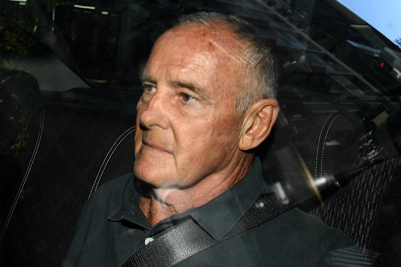 Chris Dawson arrives at the Sydney Police Centre after being extradited from the Gold Coast in Sydney: EPA