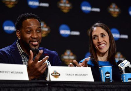 Apr 1, 2017; Glendale, AZ, USA; NBA former player Tracy McGrady speaks are WNBA former player Rebecca Lobo listens during the Naismith Hall of Game Press Conference at University of Phoenix Stadium. Mandatory Credit: Joe Camporeale-USA TODAY Sports