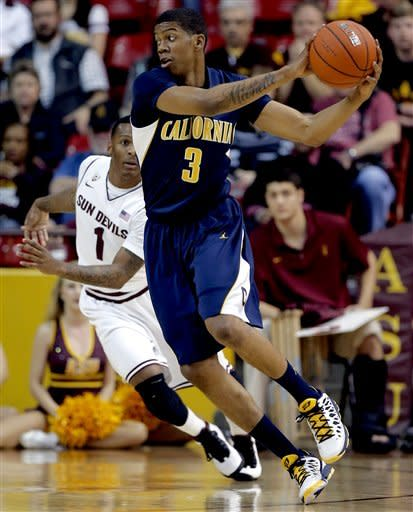 California's Tyrone Wallace (3) drives past Arizona State's Jahii Carson during the first half of an NCAA college basketball game, Thursday, Feb. 7, 2013, in Tempe, Ariz. (AP Photo/Matt York)