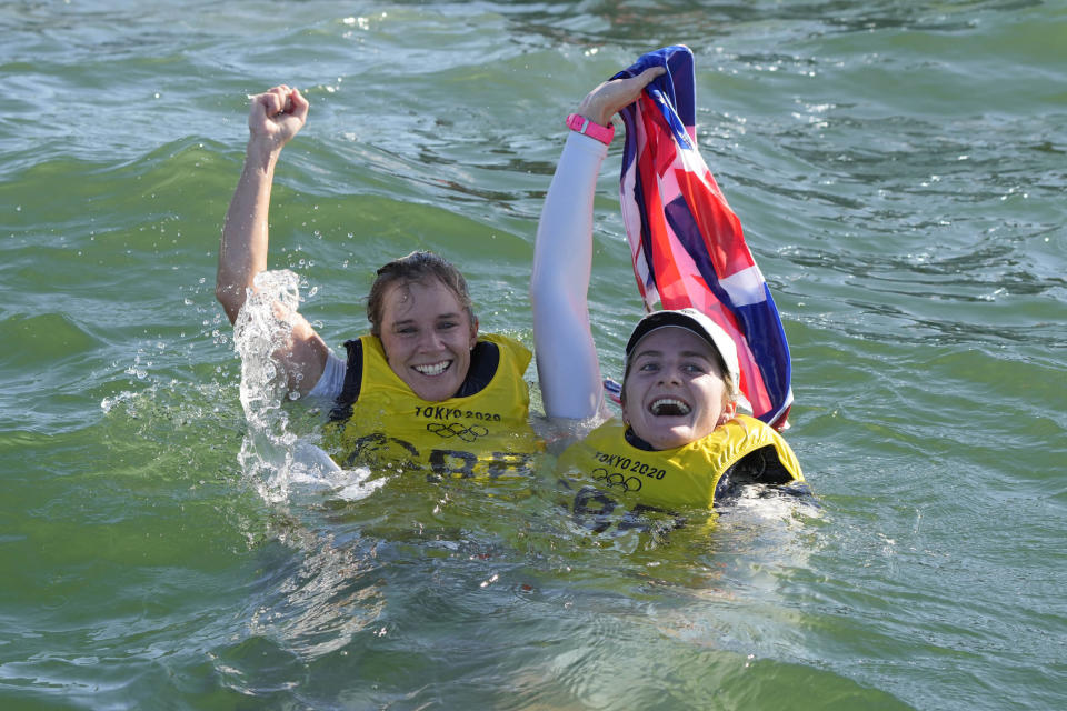 Hannah Mills and Eilidh McIntyre celebrate their golds in the sea