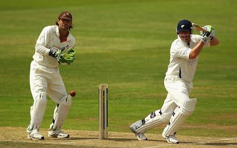 Anthony McGrath of Yorkshire hits the ball towards the boundary, as Luke Sutton of Lancashire looks on - Credit: Matthew Lewis/Getty Images
