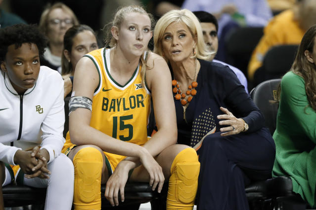 Baylor's Jordyn Oliver (11) watches play as Lauren Cox (15) and head coach Kim Mulkey, right, talk on the bench in the second half of an NCAA college basketball game in Waco, Texas, Tuesday, Nov. 5, 2019. (AP Photo/Tony Gutierrez)