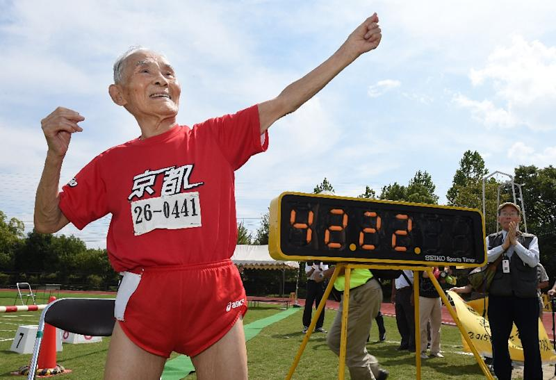 Hidekichi Miyazaki celebrates after clocking 42.22 seconds to set a 100 metres world record in the over-105 age category in Kyoto, western Japan (AFP Photo/Toru Yamanaka)