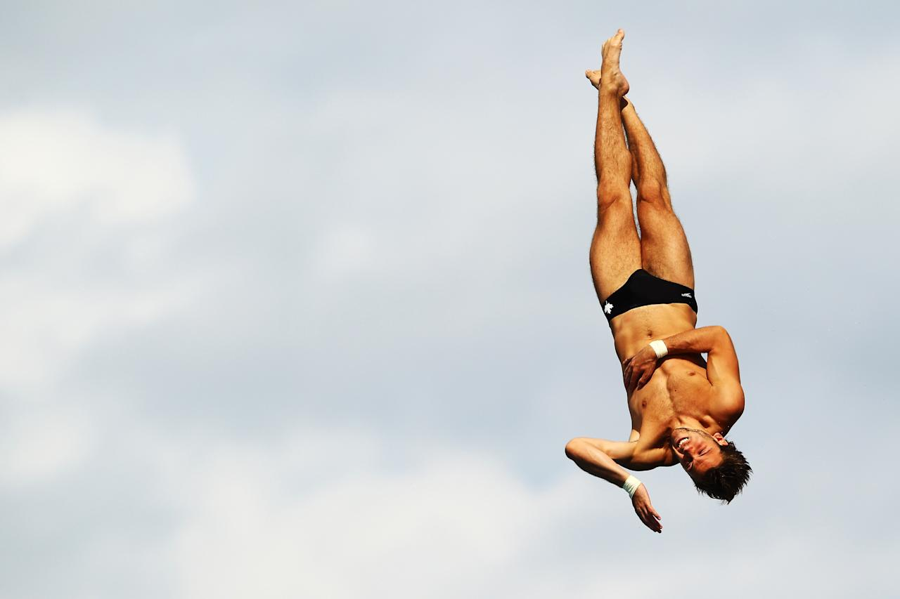 FORT LAUDERDALE, FL - MAY 10:  Riley McCormick of Canada dives during the Mens 10m Platform Semi Finals at the Fort Lauderdale Aquatic Center on Day 1 of the AT&T USA Diving Grand Prix on May 10, 2012 in Fort Lauderdale, Florida.  (Photo by Al Bello/Getty Images)