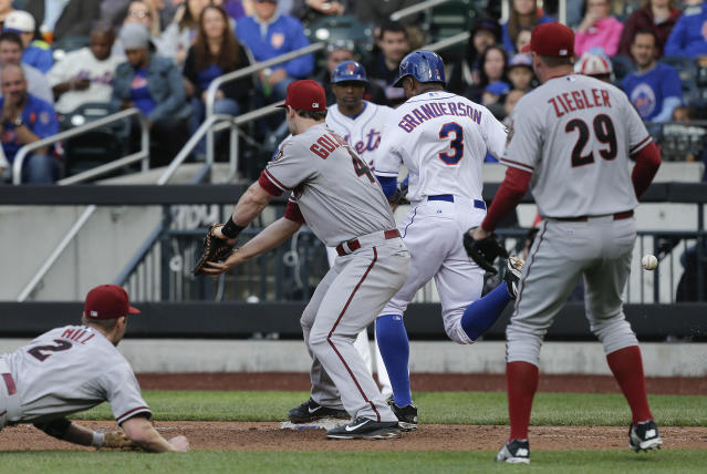 New York Mets' Curtis Granderson (3) reaches first base safely as Arizona Diamondbacks second baseman Aaron Hill (2) flips the ball wide to first baseman Paul Goldschmidt (44) on a slow ground ball during the eighth inning of a baseball game, Saturday, May 24, 2014, in New York. (AP Photo/Julie Jacobson)