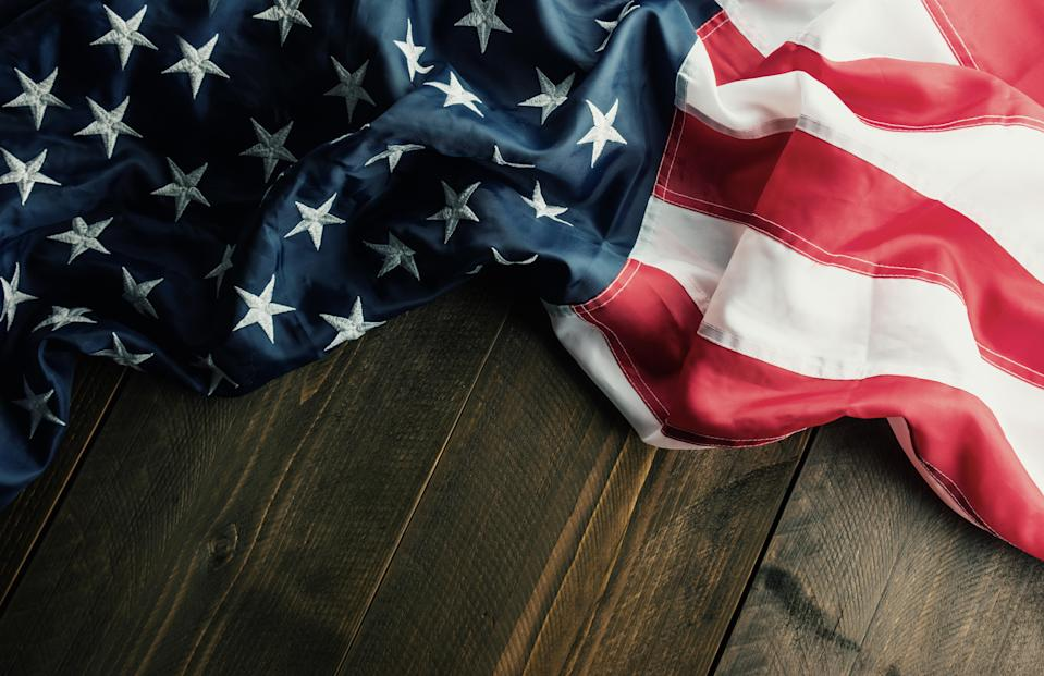 A 6th-grade boy at Lawton Chiles Middle Academy in Lakeland, Fla. was arrested after he refused to stand for the Pledge of Allegiance, claiming it was offensive to black people. (Photo: Getty Images)