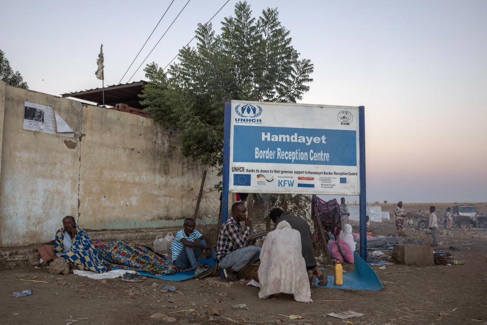 A Tigray refugees who fled the conflict in the Ethiopia's take shelter at Hamdeyat Transition Center near the Sudan-Ethiopia border, eastern Sudan, Thursday, Dec. 3, 2020. Ethiopian forces on Thursday blocked people from the country's embattled Tigray region from crossing into Sudan at the busiest crossing point for refugees, Sudanese forces said.(AP Photo/Nariman El-Mofty)
