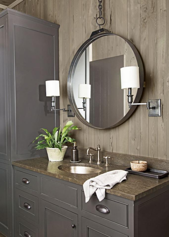 <p>Soapstone is a durable natural material ideal for spaces that take a beating, like this bathroom that doubles as a mudroom.  It's scratch-resistant and easy to clean. The surface also has an understated masculine appeal in keeping with the pecky cypress paneling, antique pewter sink, and dark bronze fixtures.</p>