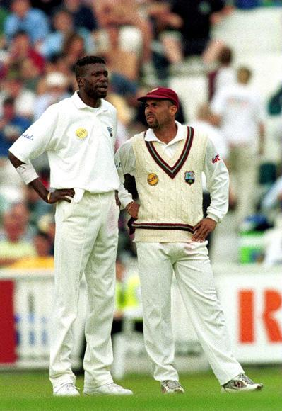 31 Aug 2000:  Captain Jimmy Adams of the West Indies looks for some inspiration from fast bowler Curtly Ambrose during the Fifth Cornhill Insurance Test between England and the West Indies at the Oval, London.  Mandatory Credit: Adrian Murrell/ALLSPORT