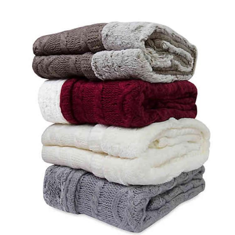 Keep warm and dress up your dorm with cozy throw blankets. (Photo: Bed Bath and Beyond)