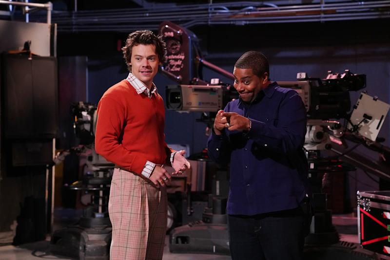 Harry Styles wears plaid trousers on