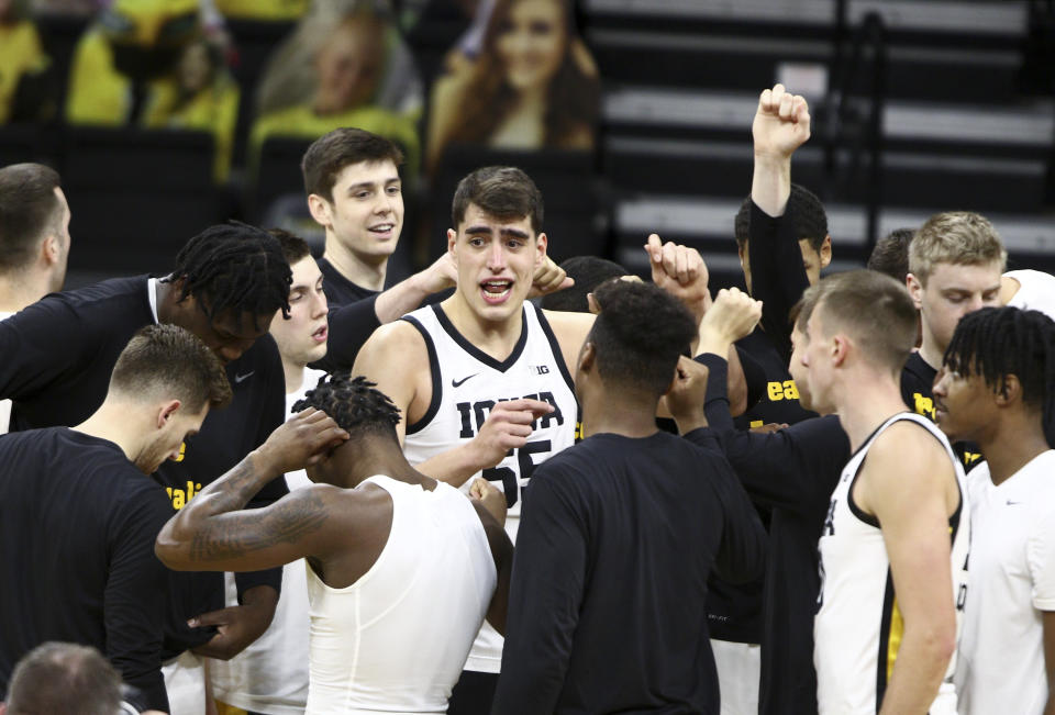 IOWA CITY, IOWA- DECEMBER 22:  Forward Luka Garza #55 of the Iowa Hawkeyes talks with his teammates before their match-up against the Purdue Boilermakers at Carver-Hawkeye Arena on December 22, 2020 in Iowa City, Iowa.  (Photo by Matthew Holst/Getty Images)