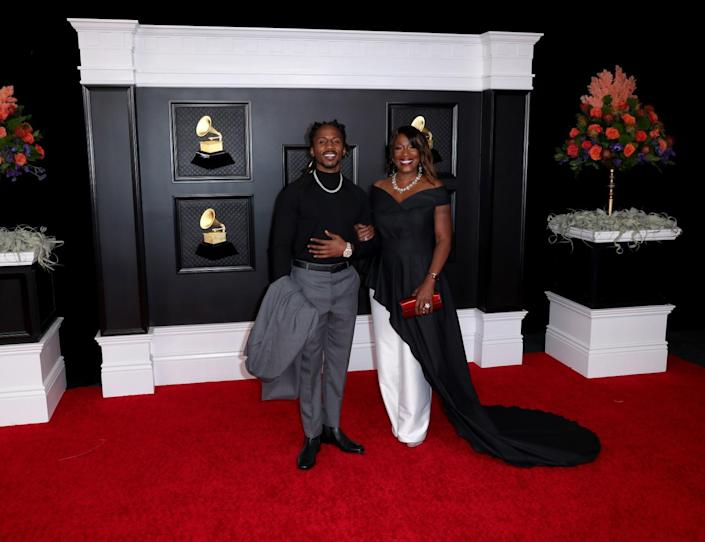 D Smoke and date on the red carpet at the 63rd Grammy Awards.