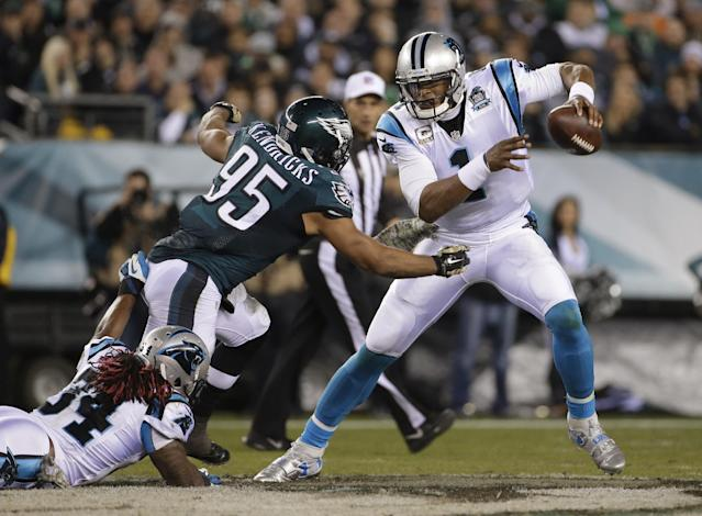 Eagles linebacker Mychal Kendricks attempts to tackle Carolina quarterback and former MVP Cam Newton. (AP)