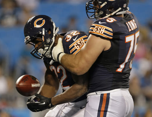 Chicago Bears' Michael Ford (32) is congratulated by teammate Kyle Long (75) after making a touchdown run against the Carolina Panthers during the second half of a preseason NFL football game in Charlotte, N.C., Friday, Aug. 9, 2013. (AP Photo/Bob Leverone)