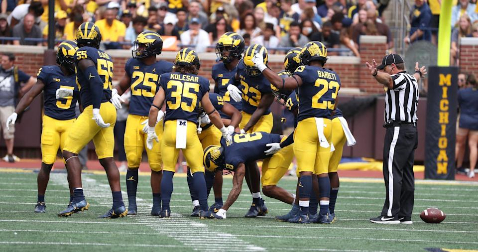Michigan Wolverines wide receiver Ronnie Bell (8) goes down due to injury during first half action against the Western Michigan Broncos Saturday, Sept. 4, 2021.