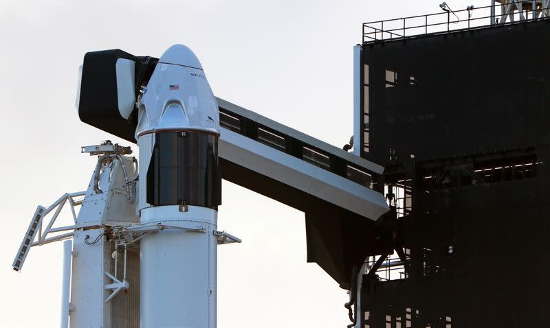 The SpaceX Crew Dragon sits atop a Falcon 9 booster rocket on Pad 39A at Kennedy Space Center before a scheduled in-flight abort test