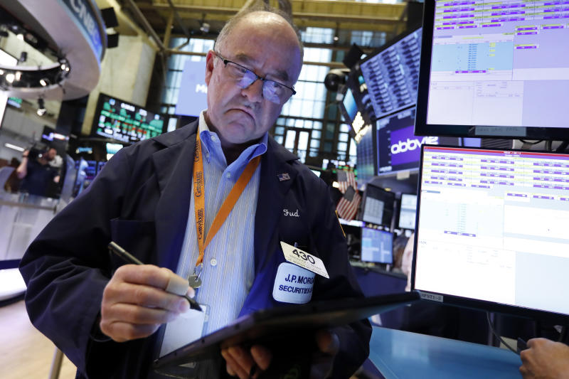 Trader Fred Reimer works on the floor of the New York Stock Exchange, Friday, July 19, 2019. U.S. stocks moved broadly higher in early trading on Wall Street Friday and chipped away at the week's losses. (AP Photo/Richard Drew)