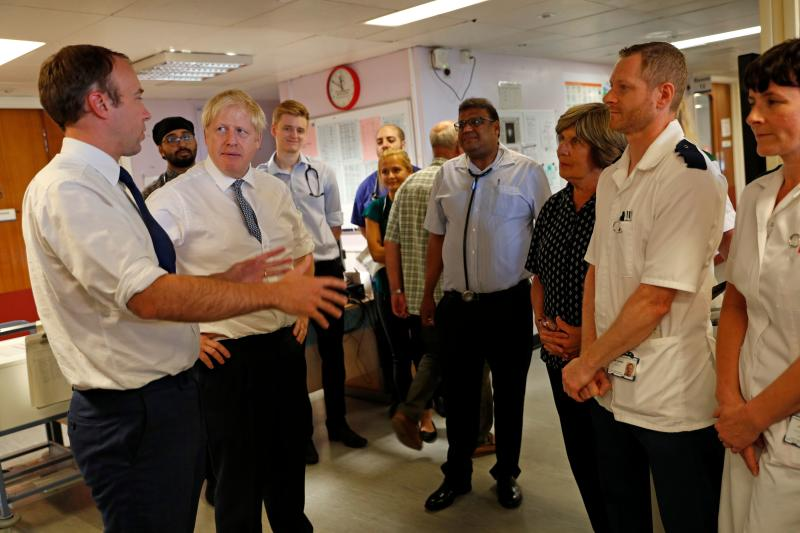 Mr Johnson and Health Secretary Matt Hancock announced the recipients of the £1.8 billion in funding on a visit to Pilgrim Hospital in Boston on Monday. (Getty)