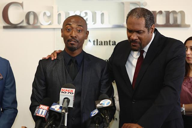 Darris Love and attorney Brian Dunn speak during a press conference at the Cochran Firm on Tuesday in Los Angeles. (Photo: Frederick M. Brown/Getty Images)