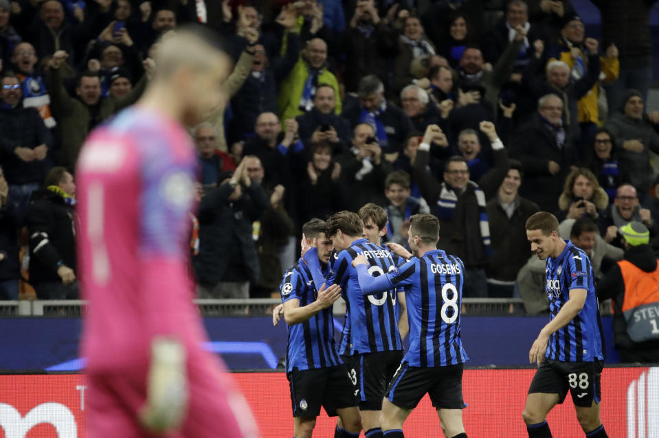 Atalanta's Remo Freuler celebrates with teammates after scoring his side's third goal during the Champions League round of 16, first leg, soccer match between Atalanta and Valencia at the San Siro stadium in Milan, Italy, Wednesday, Feb. 19, 2020. (AP Photo/Luca Bruno)