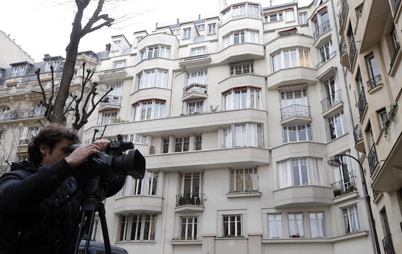 The building believed to contain the home of Managing Director of the International Monetary Fund Christine Lagarde, in Paris, Wednesday, March 20, 2013 after her lawyer says French investigators have searched it  as part of an inquiry into her role in a $400 million arbitration deal in favor of a tycoon, Bernard Tapie who won a 2008 settlement with a state-owned bank over the mishandled sale of Adidas in the 1990s. (AP Photo/Francois Mori)