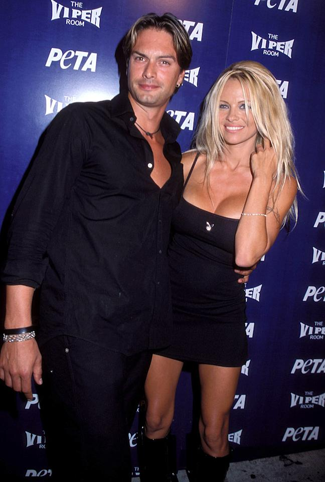 "After dating her fair share of rockers and actors, Anderson switched gears in 2000 and took up with Swedish model Marcus Schenkenberg. Not long after, the two got engaged <span style=""font-size:11.0pt; "">–</span> but it wasn't meant to last. In 2001, the ridiculously good-looking couple called it quits. Anderson claimed it was because they were just too busy and she wanted to devote her time to her kids."