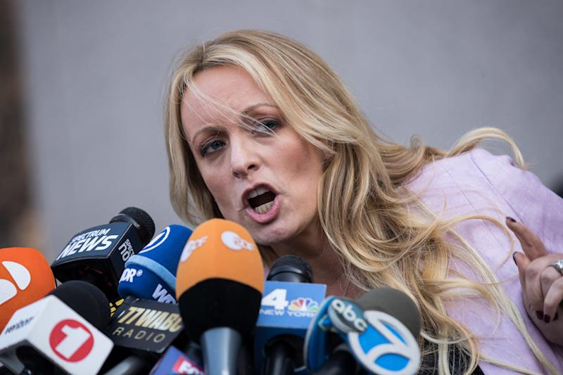 Porn actress Stormy Daniels, who claims she was paid off not to reveal an affair she had with Donald Trump, speaks to reporters in April. (Drew Angerer via Getty Images)