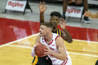 Wisconsin's Micah Potter, front, goes up against Arkansas-Pine Bluff's Alvin Stredic during the first half of an NCAA college basketball game Friday, Nov. 27, 2020, in Madison, Wis. (AP Photo/Andy Manis)