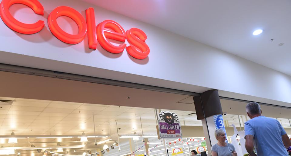 Photo shows front of Coles store.