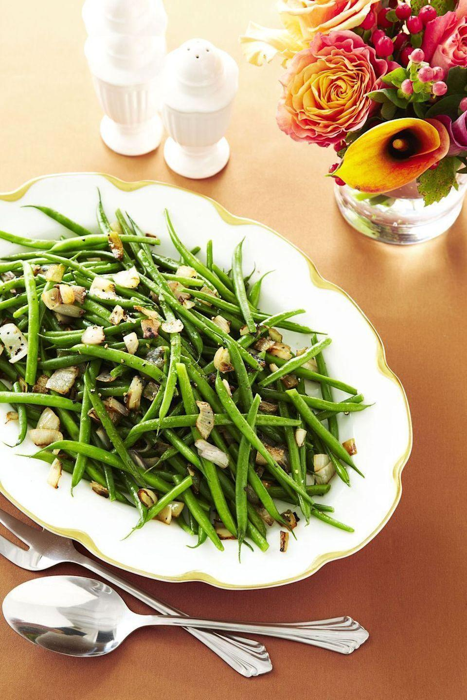 """<p>This simple side is an easy way to keep your green beans vegan this Thanksgiving. Simply use margarine instead of butter and no one will be the wiser!</p><p><em><a href=""""https://www.goodhousekeeping.com/food-recipes/a9458/green-beans-shallots-thanksgiving-recipes/"""" rel=""""nofollow noopener"""" target=""""_blank"""" data-ylk=""""slk:Get the recipe for Green Beans with Shallots »"""" class=""""link rapid-noclick-resp"""">Get the recipe for Green Beans with Shallots »</a></em> </p>"""
