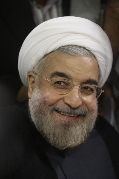 "In this Tuesday, May 7, 2013 photo, Iranian President elect, Hasan Rouhani, a former Iran's top nuclear negotiator, smiles, as he registers his name for the candidacy of the presidential election, at the interior ministry, in Tehran, Iran. Just a week before Iran's election gatekeepers announced the presidential ballot, Rouhani described the U.S. as the world's ""sheriff"" and said direct talks with Washington are the only way for breakthroughs in the nuclear standoff. (AP Photo/Vahid Salemi)"