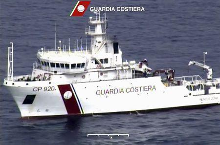 An Italian coast guard vessel is seen during the search and rescue operation underway after a boat carrying migrants capsized overnight, with up to 700 feared dead, in this still image taken from video April 19, 2015. REUTERS/Guardia Costiera/Handout via Reuters TV