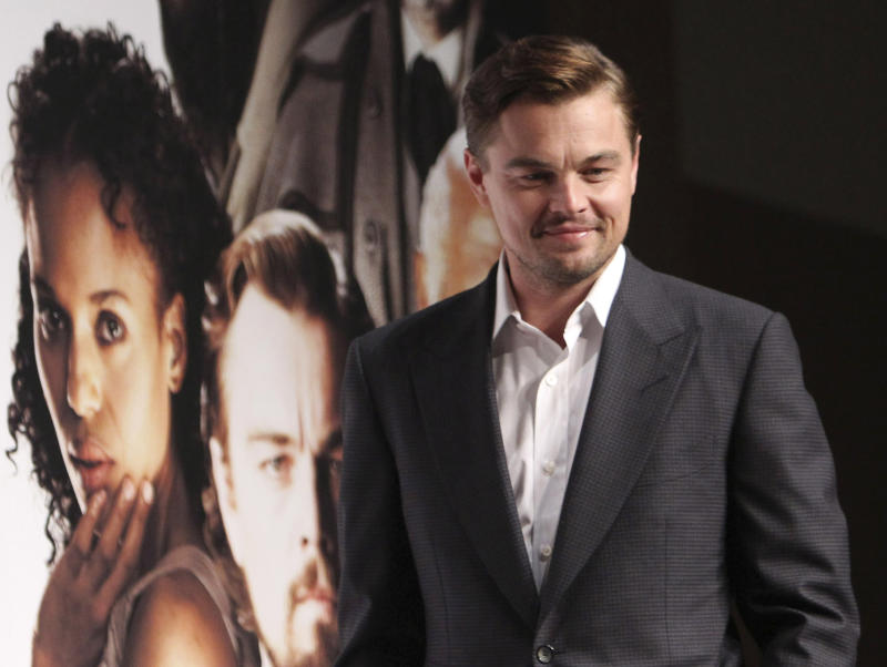 "In this Saturday, March 2, 2013 photo, actor Leonardo DiCaprio poses for a photo call during a press conference to promote his new film ""DJango Unchained"" in Tokyo. The Hollywood film ""Django Unchained"" has been pulled from Chinese theaters on its opening day, despite weeks of promotion for director Quentin Tarantino's violent slave-revenge saga. Movie theaters throughout China said Thursday, April 11, 2013 that they were ordered to suspend the film. (AP Photo/Junji Kurokawa)"