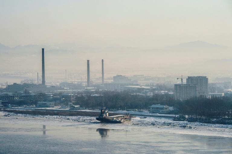 This photo taken on January 9, 2018 shows the North Korean town of Sinuiju, seen from Dandong in China's northeast Liaoning province