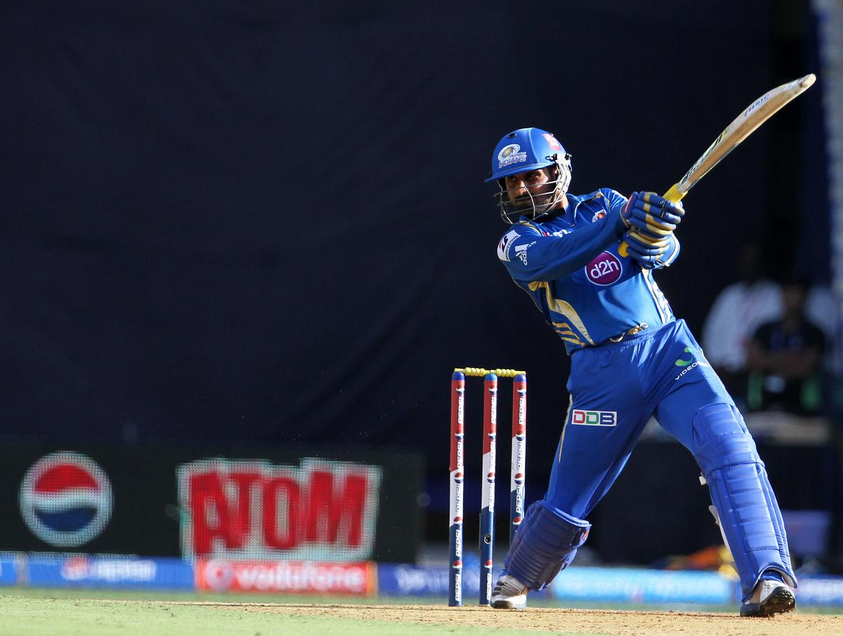 Mumbai Indian player Harbhajan Singh plays a shot during match 49 of the Pepsi Indian Premier League ( IPL) 2013  between The Mumbai Indians and the Chennai Super Kings held at the Wankhede Stadium in Mumbai on the 5th May 2013 ..Photo by Vipin Pawar-IPL-SPORTZPICS ..Use of this image is subject to the terms and conditions as outlined by the BCCI. These terms can be found by following this link:..https://ec.yimg.com/ec?url=http%3a%2f%2fwww.sportzpics.co.za%2fimage%2fI0000SoRagM2cIEc&t=1500647387&sig=QXgVPjofm5O9zg5kr5QNxg--~C